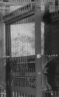 94/222/23-8/18/10 Glass negative, full plate, early chain and pulley driven totalisator pre-assembled in Automatic Totalisators Limited factory, 1913